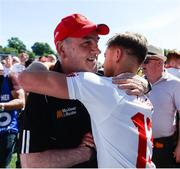 16 July 2017; A happy Tyrone manager Mickey Harte with Mark Bradley of Tyrone after the Ulster GAA Football Senior Championship Final match between Tyrone and Down at St Tiernach's Park in Clones, Co. Monaghan. Photo by Oliver McVeigh/Sportsfile