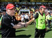 16 July 2017; Tyrone manager Mickey Harte and Down Manager Eamonn Burns exchange handshakes after the final whistle in the Ulster GAA Football Senior Championship Final match between Tyrone and Down at St Tiernach's Park in Clones, Co. Monaghan. Photo by Oliver McVeigh/Sportsfile