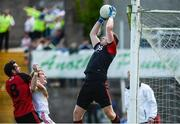 16 July 2017; Michael Cunningham of Down makes a save under the crossbar as Peter Harte of Tyrone and Kevin McKernan of Down challnge during the Ulster GAA Football Senior Championship Final match between Tyrone and Down at St Tiernach's Park in Clones, Co. Monaghan. Photo by Oliver McVeigh/Sportsfile