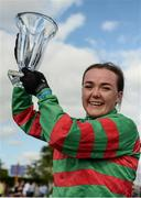 16 July 2017; Lynne McLoughlin lifts the trophy after winning the Corinthian Challenge Charity Race Series on Nearly Famous during Day 2 of the Darley Irish Oaks Weekend at the Curragh in Kildare. Photo by Cody Glenn/Sportsfile