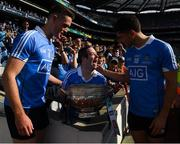 16 July 2017; Sean Jordan, from Old Bawn, Tallaght, with Dublin stars Brian Fenton and Bernard Brogan and the Delaney Cup after the Leinster GAA Football Senior Championship Final match between Dublin and Kildare at Croke Park in Dublin. Photo by Ray McManus/Sportsfile