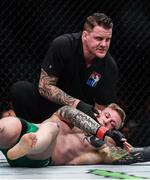 16 July 2017; Referee Marc Goddard with Charlie Ward after he was knocked outby Galore Bofando during their welterweight bout at UFC Fight Night Glasgow in the SSE Hydro Arena in Glasgow. Photo by Ramsey Cardy/Sportsfile