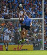 16 July 2017; Kildare goalkeeper Mark Donnellan punches the ball clear under pressure from Dublin players Paul Mannion and Brian Fenton during the final minutes of the Leinster GAA Football Senior Championship Final match between Dublin and Kildare at Croke Park in Dublin. Photo by Ray McManus/Sportsfile