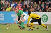 17 March 2012; Eugene Magee, Ireland, in action against Ikmar Mohd Nor Mohd Madzli, Malaysia. Men's 2012 Olympic Qualifying Tournament, Ireland v Malaysia, National Hockey Stadium, UCD, Belfield, Dublin. Picture credit: Barry Cregg / SPORTSFILE