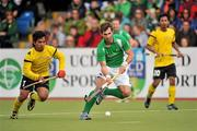 17 March 2012; William Geoffrey McCabe, Ireland, in action against Fitri Mohd Saari, Malaysia. Men's 2012 Olympic Qualifying Tournament, Ireland v Malaysia, National Hockey Stadium, UCD, Belfield, Dublin. Picture credit: Barry Cregg / SPORTSFILE