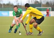 17 March 2012; John Jackson, Ireland, in action against Marhan Mohd Jalil Muhammad, Malaysia. Men's 2012 Olympic Qualifying Tournament, Ireland v Malaysia, National Hockey Stadium, UCD, Belfield, Dublin. Picture credit: Barry Cregg / SPORTSFILE