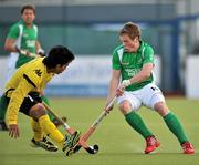 17 March 2012; GIan Sloan, Ireland, in action against Fitri Mohd Saari, Malaysia. Men's 2012 Olympic Qualifying Tournament, Ireland v Malaysia, National Hockey Stadium, UCD, Belfield, Dublin. Picture credit: Barry Cregg / SPORTSFILE