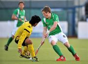 17 March 2012; Ian Sloan, Ireland, in action against Fitri Mohd Saari, Malaysia. Men's 2012 Olympic Qualifying Tournament, Ireland v Malaysia, National Hockey Stadium, UCD, Belfield, Dublin. Picture credit: Barry Cregg / SPORTSFILE