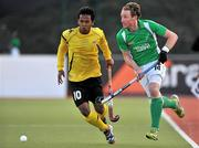 17 March 2012; Andrew McConnell, Ireland, in action against Faizal Saari, Malaysia. Men's 2012 Olympic Qualifying Tournament, Ireland v Malaysia, National Hockey Stadium, UCD, Belfield, Dublin. Picture credit: Barry Cregg / SPORTSFILE