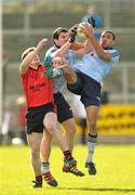 18 March 2012; Michael Darragh McAuley and Craig Dias, right, Dublin, in action against Conor Maginn, Down. Allianz Football League, Division 1, Round 5, Down v Dublin, Pairc Esler, Newry, Co. Down. Picture credit: Paul Mohan / SPORTSFILE