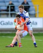 18 March 2012; Gavin McParland, Armagh, in action against Cahir Healy, Laois. Allianz Football League, Division 1, Round 5, Laois v Armagh, O'Moore Park, Portlaoise, Co. Laois. Picture credit: Diarmuid Greene / SPORTSFILE