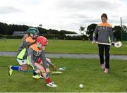 18 July 2017; Star of Wexford camogie Kate Kelly surprised youngsters taking part in one of the county's most popular Kellogg's GAA Cúl Camps with a visit to Glynn Barntown GAA Club, Killurin this week. Kate joined in what was an action-packed morning of activity and fun, teaching the children GAA skills, sharing great insider tips and promoting the importance of active play. More than 127,000 children took part in Kellogg's GAA Cúl Camps last year. The camps are for children aged 6 – 13 years who can enjoy a week of on-the-pitch action learning new skills, making new friends, being active and having fun during the school holidays in July and August. Kellogg's involvement with Cúl Camps stems from its commitment to promoting and encouraging physical activity. Educating children on the importance of nutrition to support active play is a key component of Cúl Camps and Kellogg's believes in the power of breakfast to fuel activity both on and off the pitch. The camps are in full swing and surprise visits will take place across all provinces during the summer. For more information parents can log on to www.kelloggsculcamps.gaa.ie. Photo by Seb Daly/Sportsfile