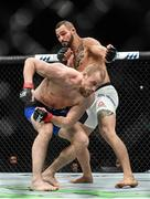 16 July 2017; Gunnar Nelson, front, in action against Santiago Ponzinibbio during their welterweight bout at UFC Fight Night Glasgow in the SSE Hydro Arena in Glasgow. Photo by Ramsey Cardy/Sportsfile