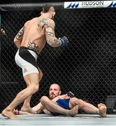 16 July 2017; Gunnar Nelson, right, is knocked out by Santiago Ponzinibbio in the first round of their welterweight bout at UFC Fight Night Glasgow in the SSE Hydro Arena in Glasgow. Photo by Ramsey Cardy/Sportsfile