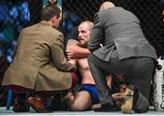 16 July 2017; Gunnar Nelson, right, recovers from being knocked out by Santiago Ponzinibbio in the first round of their welterweight bout at UFC Fight Night Glasgow in the SSE Hydro Arena in Glasgow. Photo by Ramsey Cardy/Sportsfile