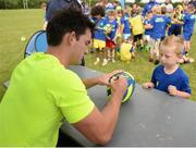 18 July 2017; Peter Dooley and Tom Daly of Leinster Rugby came out to the Bank of Ireland Summer Camp to meet up with some local young rugby talent at Portaloise RFC. Pictured Tom Daly, right, as he signs a ball for Alex Schiller, age 6, from Portlaoise, at Portlaoise RFC, in Co. Laois. Photo by Seb Daly/Sportsfile