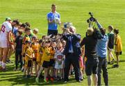 18 July 2017; In attendance during the 2017 GAA Football All Ireland Senior Championship Series National Launch at Loughmacrory St. Teresa's GAA Club, Loughmacrory, Co Tyrone, is Uachtarán Chumann Lúthchleas Aogán Ó Fearghail takes a selfie with club players and Ciarán Kilkenny of Dublin and Ronan McNamee of Tyrone with the Sam Maguire Cup. Photo by Ray McManus/Sportsfile