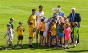 18 July 2017; In attendance during the 2017 GAA Football All Ireland Senior Championship Series National Launch at Loughmacrory St. Teresa's GAA Club, Loughmacrory, Co Tyrone, are Uachtarán Chumann Lúthchleas Aogán Ó Fearghail with club players and Ciaran Murtagh of Roscommon, Ciarán Kilkenny of Dublin and Ronan McNamee of Tyrone with the Sam Maguire Cup. Photo by Ray McManus/Sportsfile