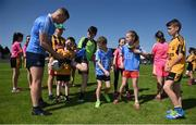 18 July 2017; In attendance during the 2017 GAA Football All Ireland Senior Championship Series National Launch at Loughmacrory St. Teresa's GAA Club, Loughmacrory, Co Tyrone, is Ciarán Kilkenny of Dublin signing autographs with club players from the host club. Photo by Cody Glenn/Sportsfile