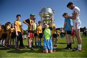 18 July 2017; In attendance during the 2017 GAA Football All Ireland Senior Championship Series National Launch at Loughmacrory St. Teresa's GAA Club, Loughmacrory, Co Tyrone, is Ronan McNamee of Tyrone signing autographs for kids with the Sam Maguire Cup. Photo by Cody Glenn/Sportsfile