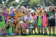 18 July 2017; In attendance during the 2017 GAA Football All Ireland Senior Championship Series National Launch at Loughmacrory St. Teresa's GAA Club, Loughmacrory, Co Tyrone, is Ronan McNamee of Tyrone with club players from the host club and the Sam Maguire Cup. Photo by Cody Glenn/Sportsfile
