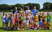 18 July 2017; In attendance during the 2017 GAA Football All Ireland Senior Championship Series National Launch at Loughmacrory St. Teresa's GAA Club, Loughmacrory, Co Tyrone, is Uachtarán Chumann Lúthchleas Aogán Ó Fearghail with, from left, Ciaran Murtagh of Roscommon, Ciarán Kilkenny of Dublin, Ronan McNamee of Tyrone and club players from the host club with the Sam Maguire Cup. Photo by Cody Glenn/Sportsfile