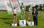 15 July 2017; Medal winners, from left, Lucy Lewis-Ward James Allen Girls, London, representing England, third place, Sarah Glennon of St Finians College, representing Ireland, winner, and Maria Flynn of St Mary's College, Naas, representing Ireland, second place, with Frank Greally, Editor of Irish Runner ,after the Girls 3km Walk event during the SIAB T&F Championships at Morton Stadium in Santry, Co. Dublin. Photo by Piaras Ó Mídheach/Sportsfile