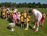18 July 2017; Ronan McNamee of Tyrone signs the jersey of Conal O'Brien, aged 9, as his club mates queue during the 2017 GAA Football All Ireland Senior Championship Series National Launch at Loughmacrory St. Teresa's GAA Club, Loughmacrory, Co Tyrone with the Sam Maguire Cup. Photo by Ray McManus/Sportsfile