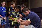 19 July 2017; Leinster's Cian Healy signs an autograph for Micah Musonda at the Bank of Ireland Leinster Rugby Summer Camp in Dundalk, Co Louth. Photo by Matt Browne/Sportsfile