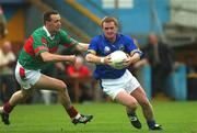 27 July 2002; Paul Cahill, Tipperary, in action against David Brady, Mayo. Mayo v Tipperary, Bank of Ireland Football Qualifiers Round 4, Cusack Park, Ennis, Co. Clare. Picture credit; Damien Eagers / SPORTSFILE *EDI*