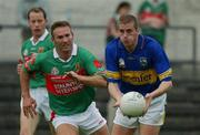 27 July 2002; Kevin Mulryan, Tipperary, in action against Colm McManaman, Mayo. Mayo v Tipperary, Bank of Ireland Football Qualifiers Round 4, Cusack Park, Ennis, Co. Clare. Picture credit; Damien Eagers / SPORTSFILE *EDI*