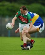 27 July 2002; David Tiernan, Mayo, in action against Eamon Hanrahan, Tipperary. Mayo v Tipperary, Bank of Ireland Football Qualifiers Round 4, Cusack Park, Ennis, Co. Clare. Picture credit; Damien Eagers / SPORTSFILE *EDI*