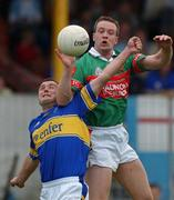 27 July 2002; David Brady, Mayo, in action against Fergal O'Callaghan, Tipperary. Mayo v Tipperary, Bank of Ireland Football Qualifiers Round 4, Cusack Park, Ennis, Co. Clare. Picture credit; Damien Eagers / SPORTSFILE *EDI*