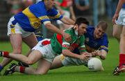 27 July 2002; Brian Maloney, Mayo, in action against Kevin Mulryan, Tipperary. Mayo v Tipperary, Bank of Ireland Football Qualifiers Round 4, Cusack Park, Ennis, Co. Clare. Picture credit; Damien Eagers / SPORTSFILE *EDI*