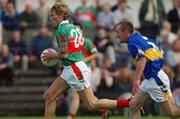 27 July 2002; Ciaran McDonald, Mayo, in action against Bernard Hahessy, Tipperary. Mayo v Tipperary, Bank of Ireland Football Qualifiers Round 4, Cusack Park, Ennis, Co. Clare. Picture credit; Damien Eagers / SPORTSFILE *EDI*