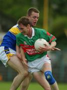 27 July 2002; James Nallen, Mayo, in action against Liam England, Tipperary. Mayo v Tipperary, Bank of Ireland Football Qualifiers Round 4, Cusack Park, Ennis, Co. Clare. Picture credit; Damien Eagers / SPORTSFILE *EDI*