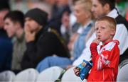 19 July 2017; A young supporter watches on during the Cork County Premier Intermediate Championship match between Blarney and Valley Rovers at Páirc Ui Chaoimh in Co. Cork. Photo by Eóin Noonan/Sportsfile