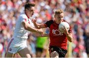 16 July 2017; Caolan Mooney of Down in action against David Mulgrew of Tyrone  during the Ulster GAA Football Senior Championship Final match between Tyrone and Down at St Tiernach's Park in Clones, Co. Monaghan. Photo by Oliver McVeigh/Sportsfile