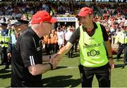 16 July 2017; Tyrone manager Mickey Harte and Down Manager Eamonn Burns exchange handshakes after the Ulster GAA Football Senior Championship Final match between Tyrone and Down at St Tiernach's Park in Clones, Co. Monaghan. Photo by Oliver McVeigh/Sportsfile
