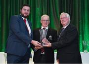 21 July 2017; Frank McEvoy, of Killeigh School, Tullamore, Co. Offaly, is presented with his John Sherlock award for services to football by Adrian Sherlock, left, and FAI President Tony Fitzgerald, right, at the FAI Communications Awards & Delegates Dinner at Hotel Kilkenny in Kilkenny. Photo by Seb Daly/Sportsfile
