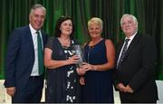 21 July 2017; Tina Murphy, second right, of Passage West SC, Co. Cork, is presented with her Jeremy Dee Services to Women's Football Award by, from left, FAI Chief Executive John Delaney, Frances Smith, and FAI President Tony Fitzgerald, at the FAI Communications Awards & Delegates Dinner at Hotel Kilkenny in Kilkenny. Photo by Seb Daly/Sportsfile