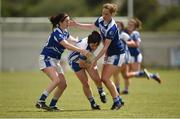 22 July 2017; Martha Kirwan of Laois in action against Aisling Doonan, left, and Claragh O'Reilly, right, of Cavan during the TG4 Senior All Ireland Championship Preliminary match between Cavan and Laois in Ashbourne, Co. Meath. Photo by Barry Cregg/Sportsfile