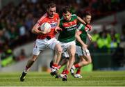 22 July 2017; Donncha O'Connor of Cork in action against Ger Cafferkey of Mayo during the GAA Football All-Ireland Senior Championship Round 4A match between Cork and Mayo at Gaelic Grounds in Co. Limerick. Photo by Piaras Ó Mídheach/Sportsfile