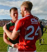 22 July 2017; Cillian O'Connor of Mayo with Ruairí Deane of Cork after the GAA Football All-Ireland Senior Championship Round 4A match between Cork and Mayo at Gaelic Grounds in Co. Limerick. Photo by Piaras Ó Mídheach/Sportsfile