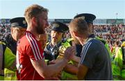 22 July 2017; Cork selector Billy Sheehan has words with referee Ciarán Branagan after the game as he is assisted from the field by members of An Garda Síochána after the GAA Football All-Ireland Senior Championship Round 4A match between Cork and Mayo at Gaelic Grounds in Co. Limerick. Photo by Piaras Ó Mídheach/Sportsfile