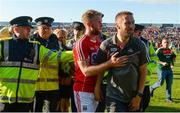 22 July 2017; Cork selector Billy Sheehan leaves the field with Stephen Cronin of Cork as referee Ciarán Branagan is assisted from the field by members of An Garda Síochána after the GAA Football All-Ireland Senior Championship Round 4A match between Cork and Mayo at Gaelic Grounds in Co. Limerick. Photo by Piaras Ó Mídheach/Sportsfile