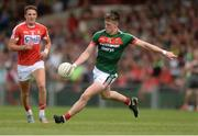 22 July 2017; Cillian O'Connor of Mayo shoots as Aidan Walsh of Cork looks on during the GAA Football All-Ireland Senior Championship Round 4A match between Cork and Mayo at Gaelic Grounds in Co. Limerick. Photo by Piaras Ó Mídheach/Sportsfile