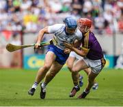 23 July 2017; Michael Walsh of Waterford in action against Willie Devereux of Wexford during the GAA Hurling All-Ireland Senior Championship Quarter-Final match between Wexford and Waterford at Páirc Uí Chaoimh in Cork. Photo by Ray McManus/Sportsfile