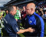 23 July 2017; Wexford manager Davy Fitzgerald, left,  with Waterford manager Derek McGrath following the GAA Hurling All-Ireland Senior Championship Quarter-Final match between Wexford and Waterford at Páirc Uí Chaoimh in Cork. Photo by Stephen McCarthy/Sportsfile