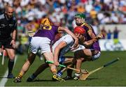 23 July 2017; Tadhg de Búrca of Waterford is tackled by Podge Doran, left, and Simon Donohoe of Wexford during the GAA Hurling All-Ireland Senior Championship Quarter-Final match between Wexford and Waterford at Páirc Uí Chaoimh in Cork. Photo by Ray McManus/Sportsfile